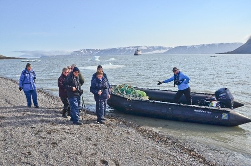 Passengers and the haul of discarded fishing gear they cleared from the beach